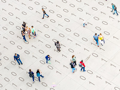 People walking over binary code
